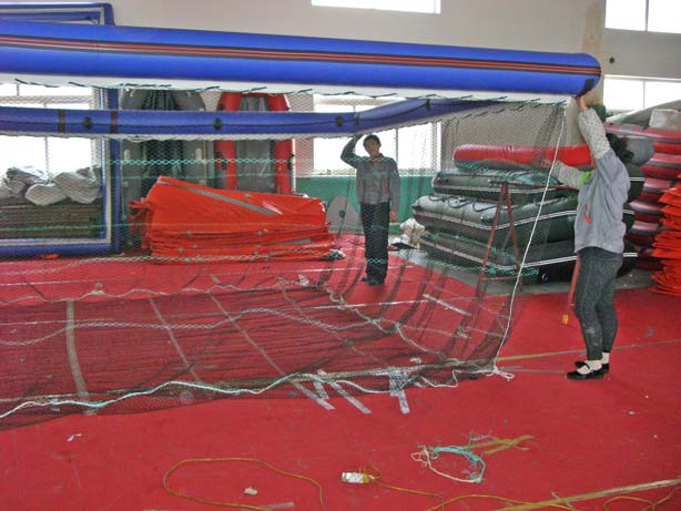 Underwater netting forms protective swimming enclosure